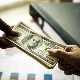 Cash being handed between people