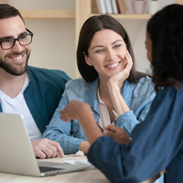 People discuss with realtor over computer